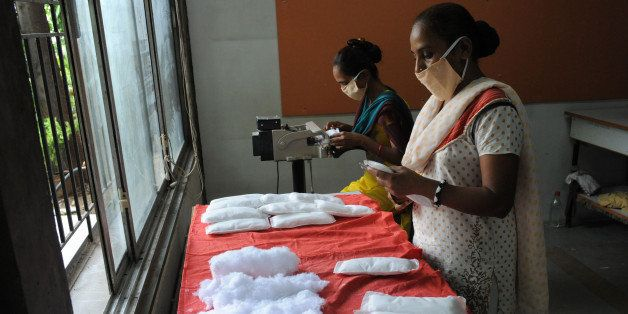 Members of Self Employed Women's Association (SEWA) make low cost sanitary pads at their facility in Ahmedabad on September 3