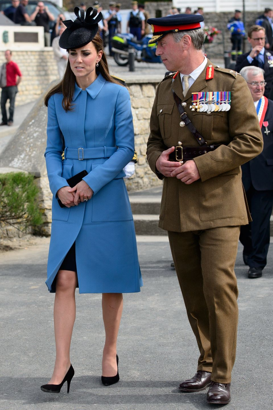 Princess Catherine, Duchess of Cambridge, speaks to a soldier in Arromanches-les-Bains, on June 6, 2014, during an event comm