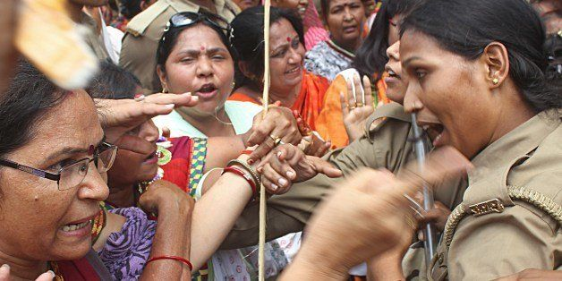 Indian Bharatiya Janata Party (BJP) demonstrators argue with policewomen during a protest against the recent gang-rape and mu
