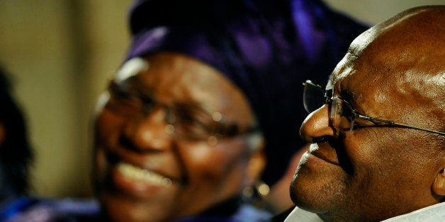 Archbishop Emeritus Desmond Tutu (R) smiles, as his wife Leah (L) smiles at him during the launch of Tutu'sauthorised biograp