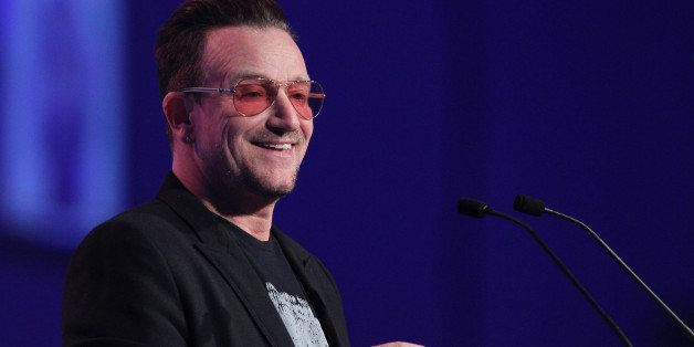 Irish singer and frontman of U2, Bono addresses delegates at the Dublin Convention Centre in Dublin, Ireland, on March 7, 201