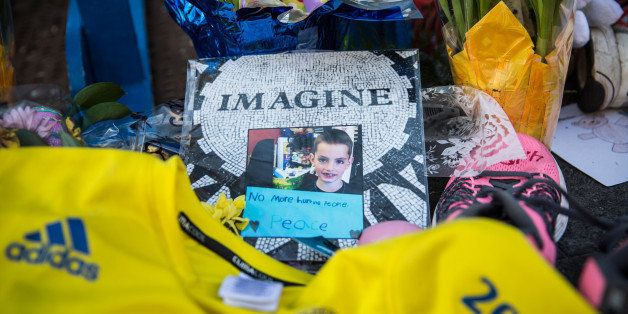 BOSTON, MA - APRIL 20:  A photo of Martin Richard, a victim of the Boston Marathon bombing, is displayed near the finish line