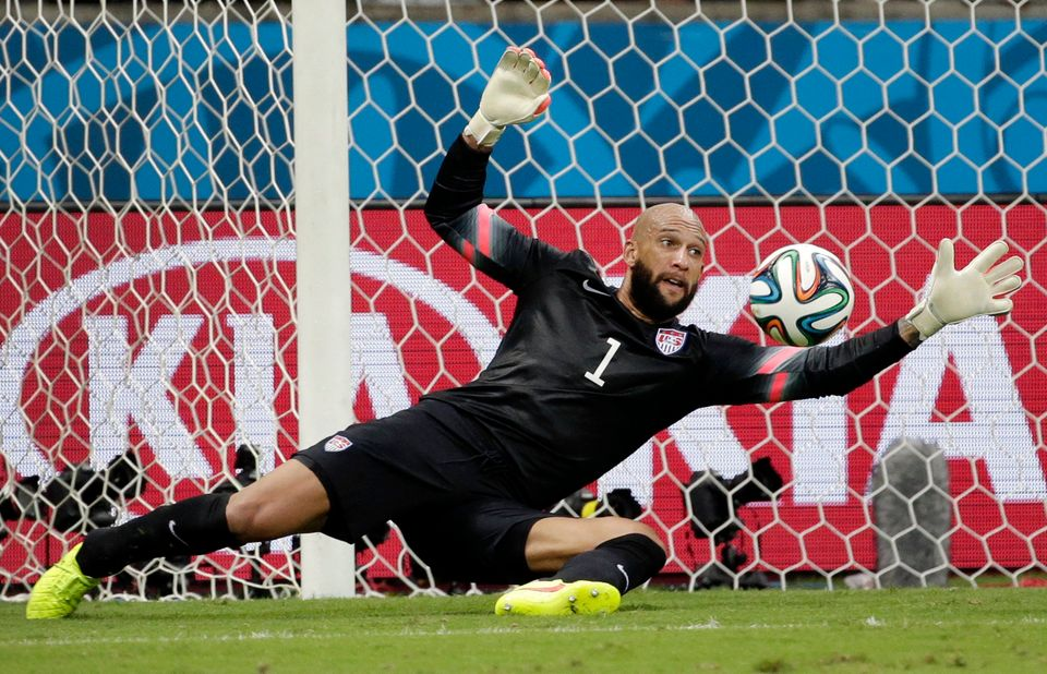 United States' goalkeeper Tim Howard saves a shot by Belgium during the World Cup round of 16 soccer match between Belgium an