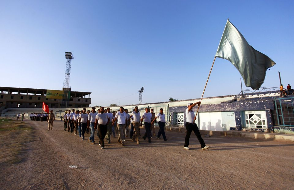 Shiite Iraqi volunteers, with the Ashura Brigade, take part in a military training in the shrine city of Najaf, in central Ir