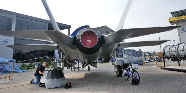 A staff member prepares the replica of Lockheed Martin F-35 fighter jet at the exhibition centre ahead of the Singapore's Air