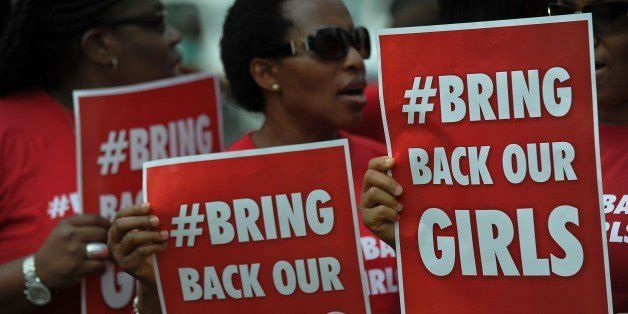 Nigerian women living in Kenya demonstrate to press for the release of Nigerian school girls kidnapped in nothern Nigeria by