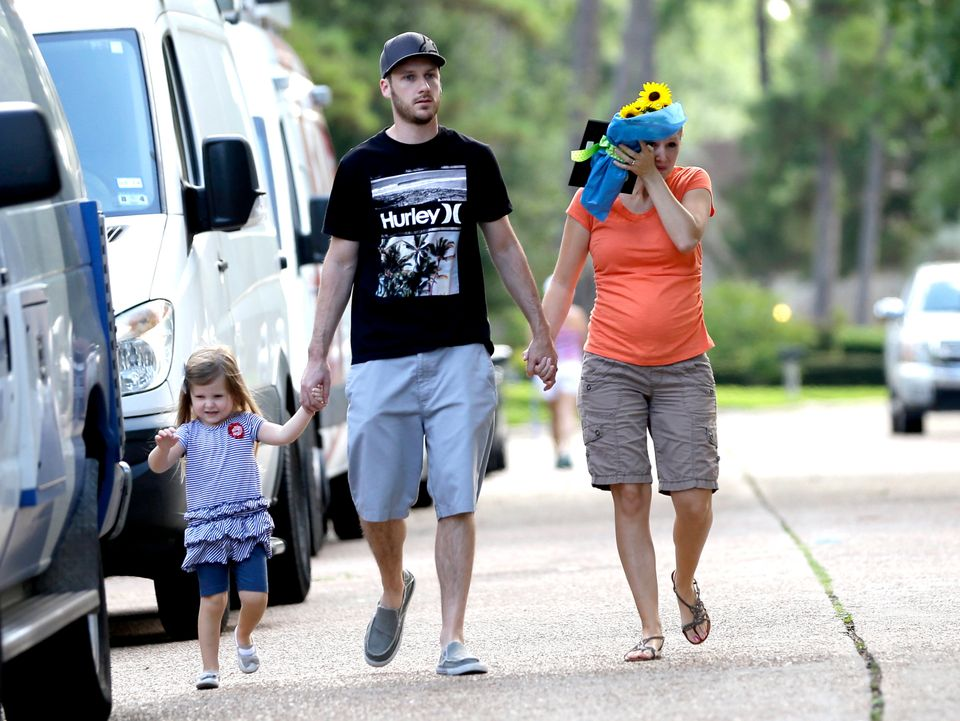 A family who identified themselves as friends of the victims, make their way to the house where six people were fatally shot
