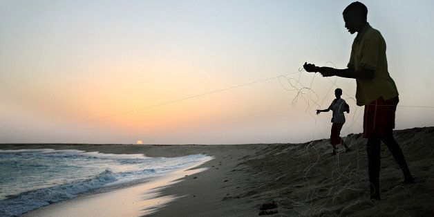 Photo made January 4, 2010 shows young Somali boys drawing their fishing lines at the coastal town of Hobyo in northeastern S