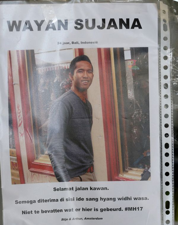A photograph of Indonesian man Wayan Sujana of Bali, believed to be missing on Air Malaysia flight MH17, is fixed to the tick
