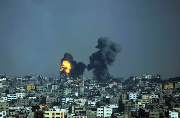 Smoke and fire from the explosion of an Israeli strike rise over Gaza City, Tuesday, July 22, 2014. Israeli airstrikes hit a