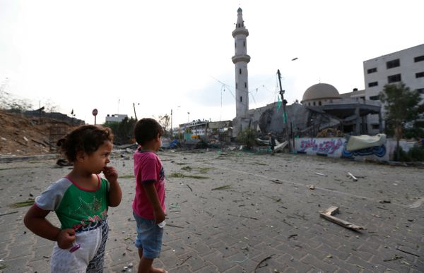 Palestinian children inspect the damage at the Al Aqsa Martyrs mosque in Gaza City, destroyed by an overnight Israeli strike,