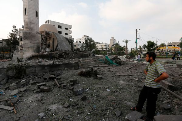 A Palestinian man inspects the Al Aqsa Martyrs mosque destroyed by an overnight Israeli strike, in Gaza City, Tuesday, July 2