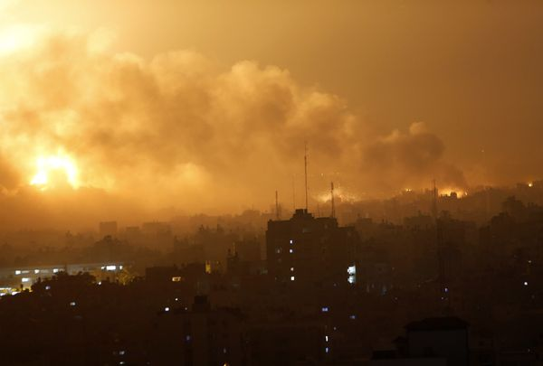 Smoke rises as flames spread across buildings after Israeli strikes in the Shijaiyah neighborhood in Gaza City, Tuesday, July