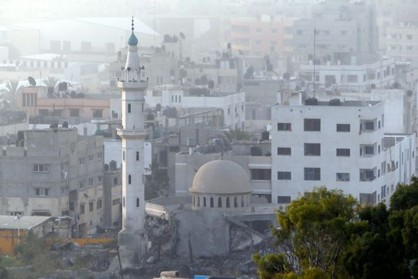 Damage can be seen at Al Aqsa Martyrs mosque in Gaza City after an Israeli strike, Tuesday, July 22, 2014. A police spokesman