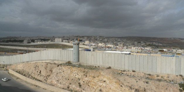 [UNVERIFIED CONTENT] The security wall that separates Israel and Palestine seen here is Ramallah in the distance behind the w