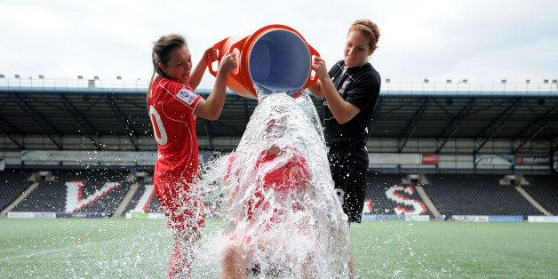 WIDNES, ENGLAND - AUGUST 24: Gemma Davison of Liverpool Ladies takes part in the 'Ice Bucket Challenge' after the FAWSL match