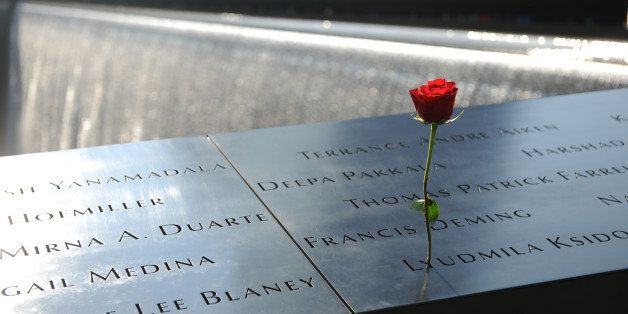 NEW YORK, NY - SEPTEMBER 11:  A flower stands in a name at the at the 9/11 Memorial during ceremonies for the twelfth anniver