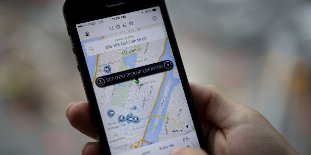 Th Uber Technologies Inc. car service application (app) is demonstrated for a photograph on an Apple Inc. iPhone in New York,