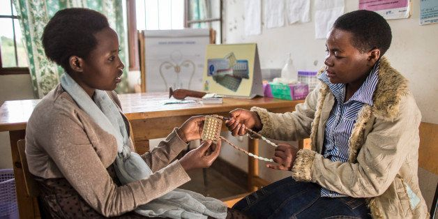 RUBONA, RWANDA - FEBRUARY 05:  The young women Tharcille Niyonagira and Joselyne Mukamazimpaka discussing the use of differen