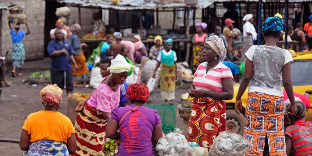 Women sell food stuff at one of the largest local markets in the city of Monrovia, Liberia, Friday, Aug. 15, 2014. The World