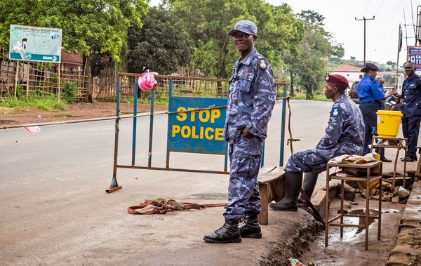 Police guard a roadblock as Sierra Leone government enforces a three day lock down on movement of all people in an attempt to
