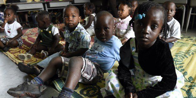 Children stand in a nursery while their parents are gone to church on September 28, 2014 in Monrovia. Liberia, the hardest-hi
