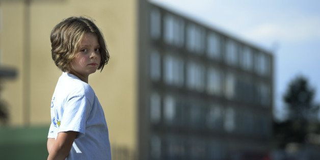 DENVER, CO. - SEPTEMBER 19: Olivia Calhoun, 9, stands outside the Crossing in Denver, CO September 19, 2014. Olivia and her f