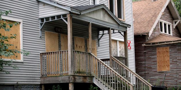 Homes are boarded-up with plywood in the Roseland neighborhood of Chicago, Illinois, U.S., on Wednesday, Aug. 28, 2013. Almos