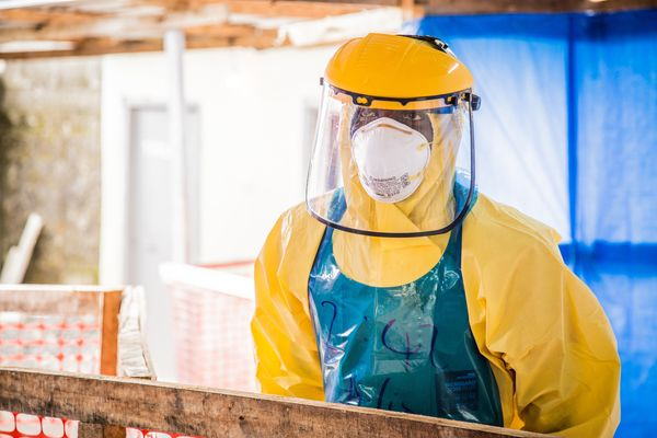 A healthcare worker in protective gear is seen at an Ebola treatment center in the west of Freetown, Sierra Leone