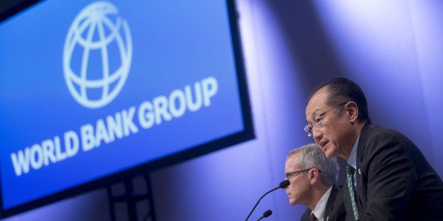 Jim Yong Kim, president of the World Bank Group, right, speaks at a news conference during the International Monetary Fund (I