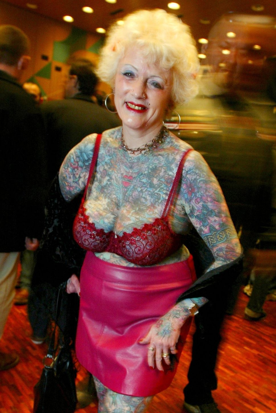 Isobel Varley from Stevenage near London, England, smiles as she poses at the 2003 International Tattoo Convention in Lausann