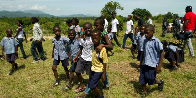 Children attend an event on ocassion of the World Environment Day in Ouanaminthe, Haiti on June 5, 2013. Haitian President Mi