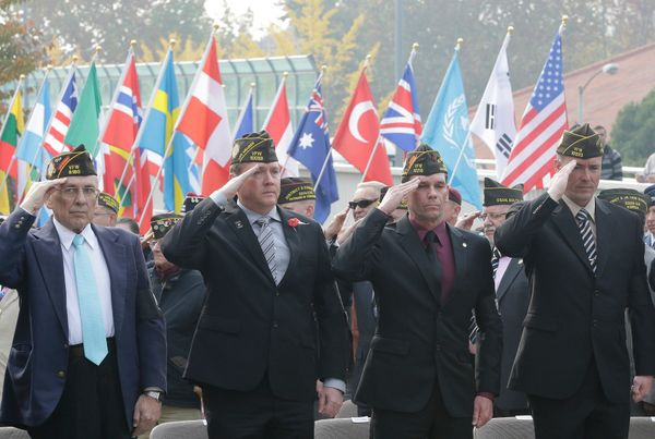 U.S. veterans, who fought in foreign wars, salute during a U.S. Veteran's Day Ceremony at Yongsan Garrison, the main U.S. mil