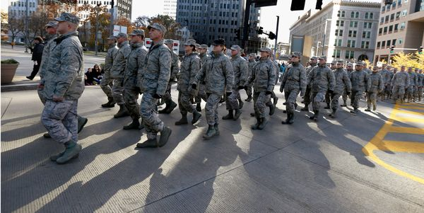Military service veterans march in the Pittsburgh Veterans Day parade on Saturday, Nov. 8, 2014, in Pittsburgh. The city move