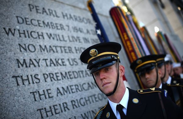 WASHINGTON, DC - NOVEMBER 11:  Members of the 'Old Guard' wait to present the colors at a Veterans Day ceremony at the World