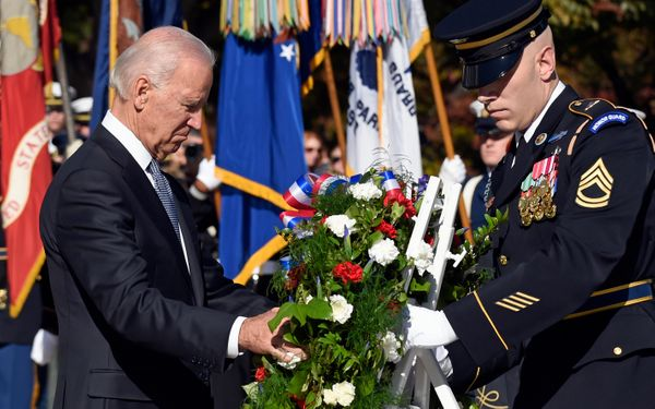 Vice President Joe Biden lays a wreath at the Tomb of the Unknowns, Tuesday, Nov. 11, 2014, at Arlington National Cemetery in
