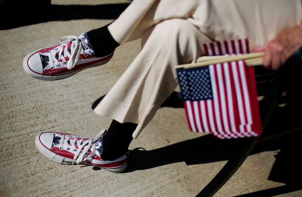 Anna Mansfield wears sneakers decorated like the American flag as she attends a Veterans Day ceremony at the Atlanta History
