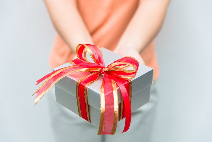 hand give silver gift box with...