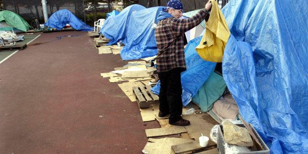 Nick Poland, a resident of Tent City 3, which is located until the end of February on the tennis courts at Seattle University
