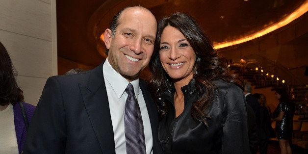 Howard Lutnick, chairman and chief executive officer of Cantor Fitzgerald LP, and wife Allison Lutnick stand for a photograph