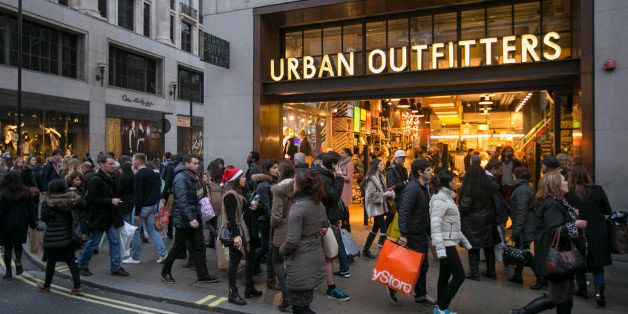 LONDON, ENGLAND - DECEMBER 14: Christmas shoppers walk outside Urban Outfitters on December 14, 2013 in London, England. As C