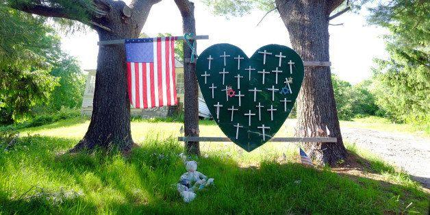 Sandy Hook Elementary School shooting, heart and cross memorial near Sandy Hook Firehouse on Riverside Road in Sandy Hook, CT