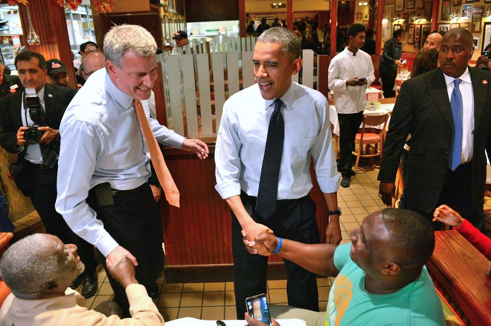 President Barack Obama, center, with New York City Democratic Mayoral Candidate Bill de Blasio, left, visit Junior's Cheeseca