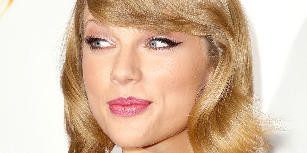 In this image released by Starpix, Taylor Swift attends the Z100's Jingle Ball 2014 at Madison Square Garden, Friday, Dec. 12