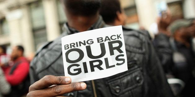 LONDON, ENGLAND - MAY 09:  A man holds a sign that reads 'Bring back our girls' during a protest outside Nigeria House on May