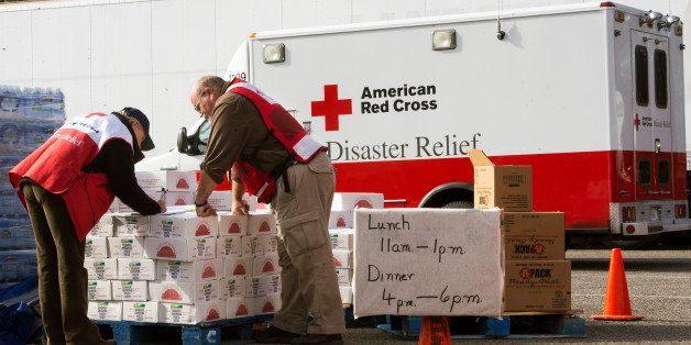 Volunteers with the American Red Cross review their notes as they distribute relief supplies to Hurricane Sandy victims Novem