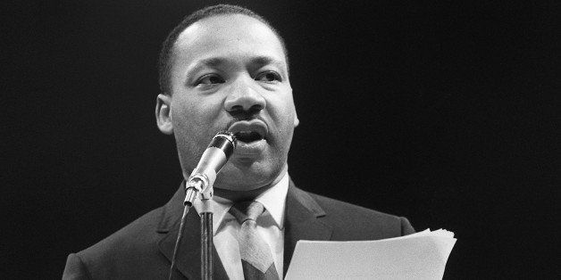 The US clergyman and civil rights leader Martin Luther King addresses, 29 March 1966 in Paris' Sport Palace the militants of