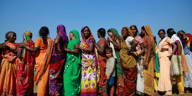 Indian women wait in a queue for check up at a free medical camp held to mark Bhim Rao Ambedkar's death anniversary in Mumbai