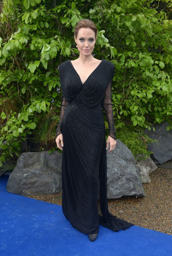 Angie dazzles in yet another Atelier Versace gown with a low v-neck and sheer sleeves.