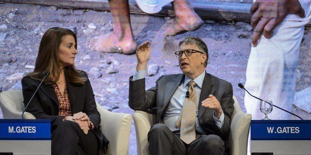 Melinda and Bill Gates attend a session at the Congress Center during the World Economic Forum (WEF) annual meeting on Januar